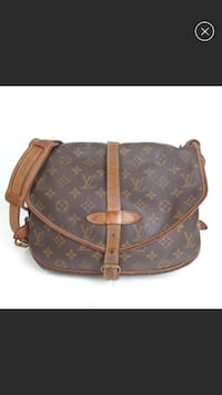 """Louis Vuitton Monogram Saumur 30  100% authentic !  Date code reads AR0970.  Height: 8.25"""" Width: 11"""" Depth: 2.5"""" Estimated Retail: $1,350.00 Condition: Good. Moderate tarnishing at hardware; moderate discoloration at leather; moderate residue at interior Howell, 07731"""