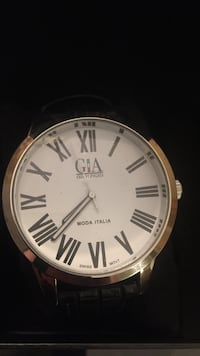 Round gia analog watch with black leather strap Mississauga, L5M 8B9
