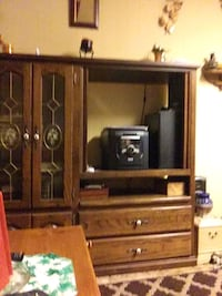 brown wooden TV hutch with flat screen television Collinsville, 74021
