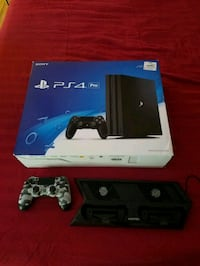PS4 PRO w/ 5 games, extra remote, and stand