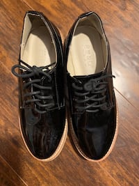 Pair of black leather shoes Toronto, M1S 4G1