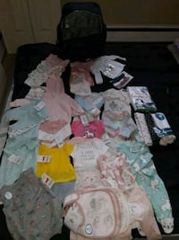 New Born clothes and stuff and a diaper bag  to go