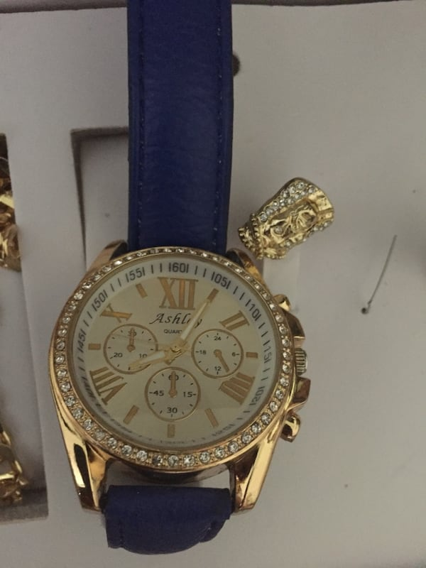 round gold-colored chronograph watch with blue leather strap fdef0b9d-11e0-4d47-9da7-97cd3c411891