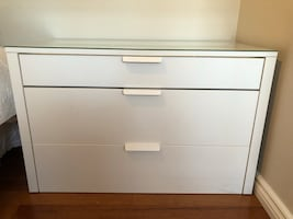 White wooden 3-drawer chest with glass top
