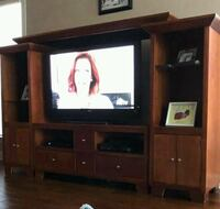 brown wooden TV hutch with flat screen television Baton Rouge, 70810