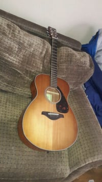 brown and black acoustic guitar Aurora