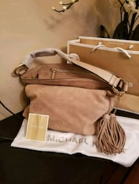 brown leather crossbody bag with fringe 3163 km