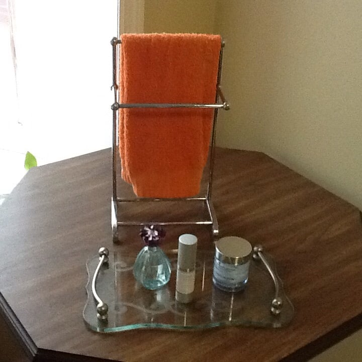 clear glass tray and hand towel rack