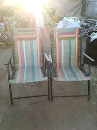 two white-and-red armchairs 2122 mi