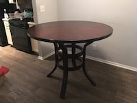 round brown wooden table with black metal base Sandy Springs, 30328