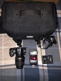 Nikon D40 w/ charger, lens, bag, flash attachment (regular flash doesn't work)