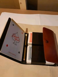 pouch with 2 decks of cards and score pad new and attractive.  Montreal