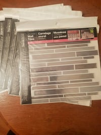 10 Stick up tiles mostly metallic silver colour