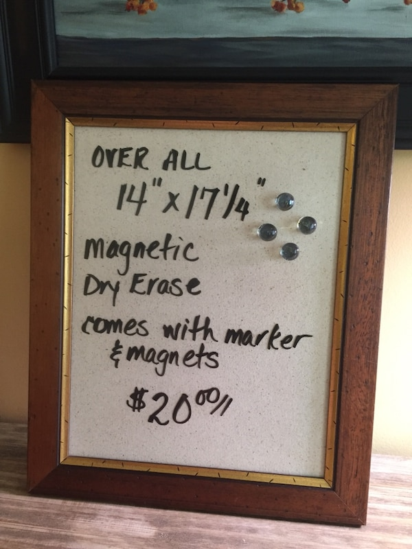brown wooden framed quote board