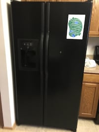 Black side-by-side refrigerator with dispenser Aurora
