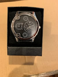 Round silver chronograph watch with black leather strap Newark, 07106