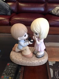 Precious Moments proposing figurine