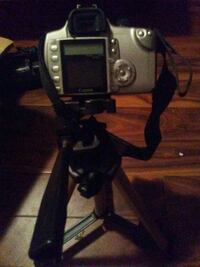 black and gray DSLR camera with black stand Moss Point