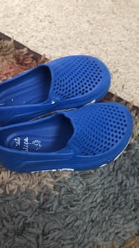 pair of blue rubber clogs