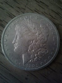 round silver-colored Morgan dollar coin Frederick, 21703
