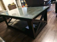 Heavy wooden coffee table with two end tables with Edmonton