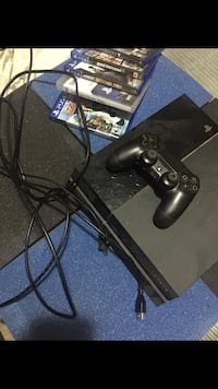 Black sony ps4 console with controller and game cases New York, 11222