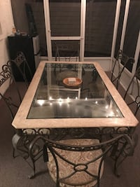 Glass patio table with 6 chairs