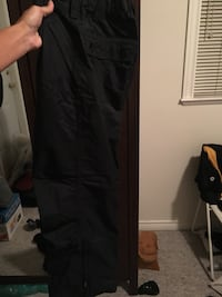 Kids size 10 Mountain Equipment black snow pants