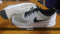 unpaired white and black Nike low-top sneaker Surrey, V3R 3S9