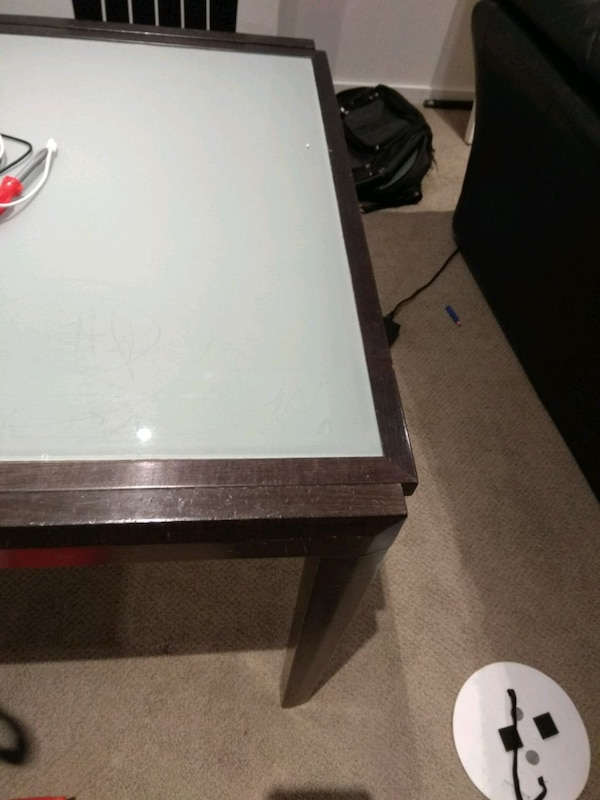 Glass table and 6 chairs, extends to seat 12 5c175e5c-db21-4869-ad8f-5b610d890087