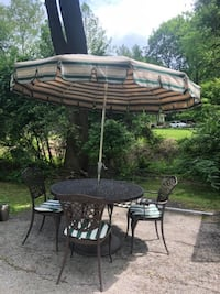 Wrought Iron Patio furniture 4 chairs two  umbrellas one table and one umbrella stand ASHBURN