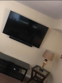 flat screen TV and black wooden TV stand 67 km
