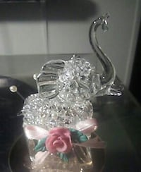 Glass elephant on a mirror stand