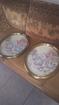 two round brown wooden framed wall decors New Port Richey, 34653