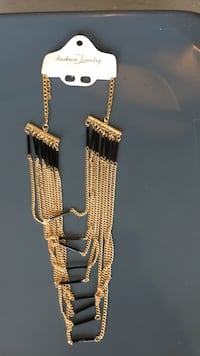 Gold chain link necklace with cross pendant