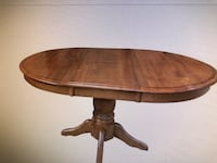 oval brown wooden pedestal table 399 mi