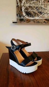 pair of black-and-white wedge sandals. NEW Bethesda, 20814