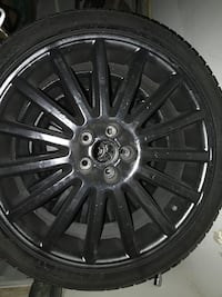 black 5-lug auto rims with tire