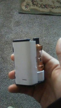 white and black box mod with tank atomizer