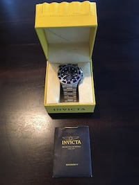 Invicta watch.  54 mm face(blue).  It's been worn 3 times.  Watch was 570.00 new.,,,- Bedford, 76022