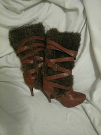 pair of brown leather stiletto knee-high mukluk boots Topeka, 66618