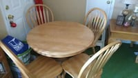 round brown wooden table with four chairs Gardendale, 35071