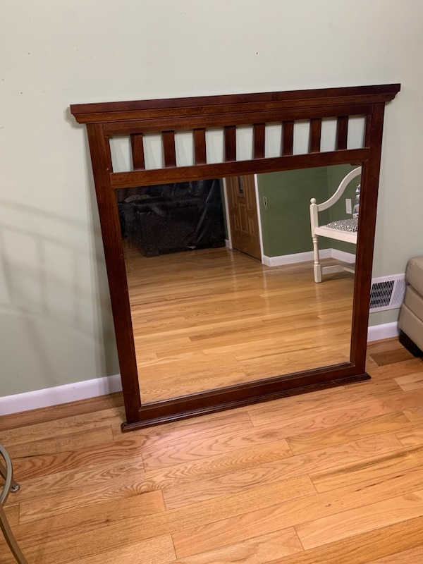 Brown wooden framed wall mirror 67e66e41-e315-4c51-b8a2-df110a504503