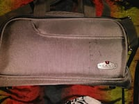 gray and black leather bag 3751 km