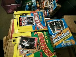 Baseball cards and basketball in box packs close
