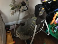baby's gray and green cradle and swing Ottawa, K2W 1C8