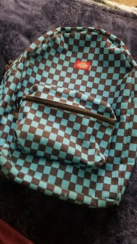 Blue and black checkered backpack