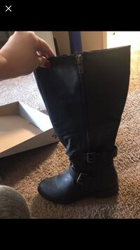 pair of black leather knee-high boots Germantown, 38138