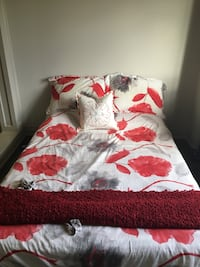 white and red floral bed sheet 558 km
