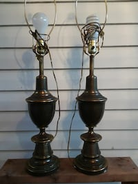 two antique matching brass lamps